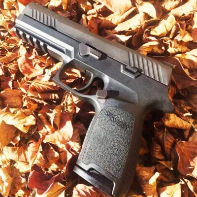 P320 offset extended magazine release
